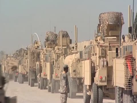 us convoy leaves iraq through camp kalsu - army stock videos & royalty-free footage
