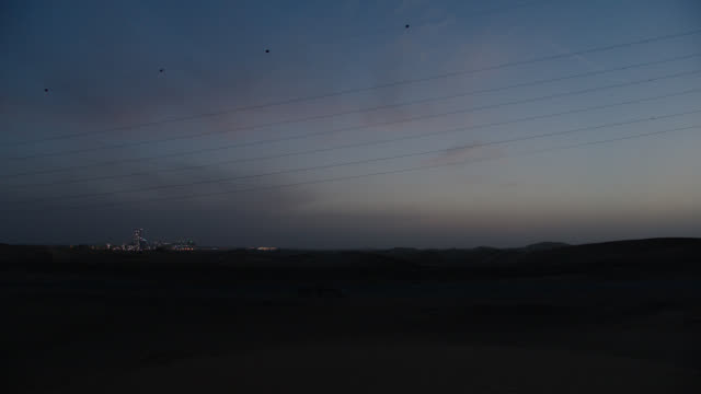 convoy of  4 - black suvs r-b l-r on 2 - lane paved desert highway - night - sports utility vehicle stock videos & royalty-free footage