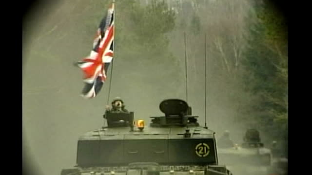 convoy of british army challenger tanks along one flying union jack flag - union army stock videos & royalty-free footage