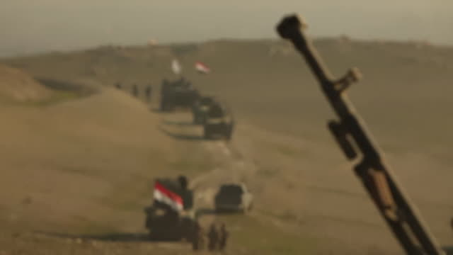 A convoy of Iraqi Army tanks and armoured vehicles coming into focus as they advance towards the Islamic State stronghold of western Mosul