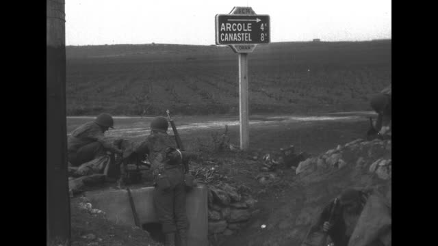 convoy of jeeps carrying us soldiers driving down road past camera / soldiers on side of road next to sign that reads arcole 4 canastel 8 / two shots... - 4x4 stock videos & royalty-free footage