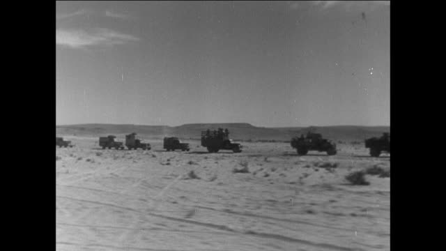 convoy of military trucks driving through the desert / egypt - israel stock videos & royalty-free footage