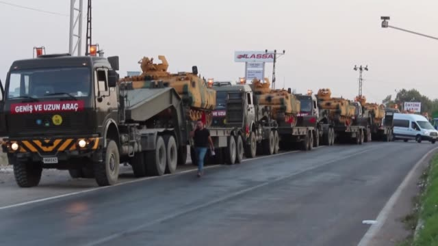a convoy of military vehicles makes its way through the turkishsyrian border in southern hatay province's reyhanli and kirikhan districts as part of... - hatay stock videos & royalty-free footage