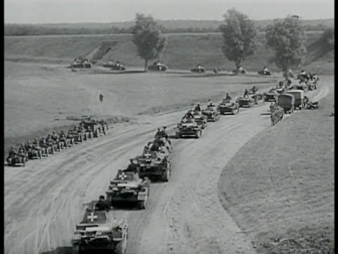 convoy of nazi german panzer tanks rolling on dirt road ms hitler w/ raised hand vs large ground cannons firing being manned by soldiers ha german... - 1939 stock videos & royalty-free footage