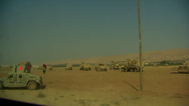 a convoy of peshmerga tanks and armoured vehicles moving through the village of fazliya after liberating it from socalled islamic state - 武力攻撃点の映像素材/bロール