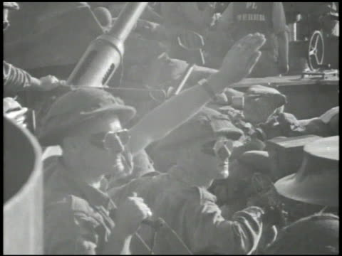 convoy of ships transporting new zealand soldiers 'kiwis' ms soldiers wearing sungoggles on deck one holding hand up to block light vs shirtless... - shirtless stock videos & royalty-free footage
