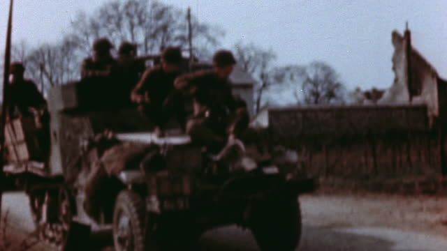 convoy of us army halftracks with troops driving slowly down village road - machine gun stock videos & royalty-free footage