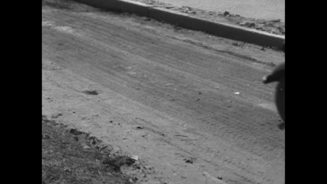 ws convoy of us army trucks crosses pontoon bridge / ms trucks cross bridge / ms convoy off bridge on dusty road / trucks on dusty road alongside... - pontoon bridge stock videos and b-roll footage