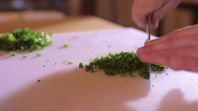 Cook chopping parsley
