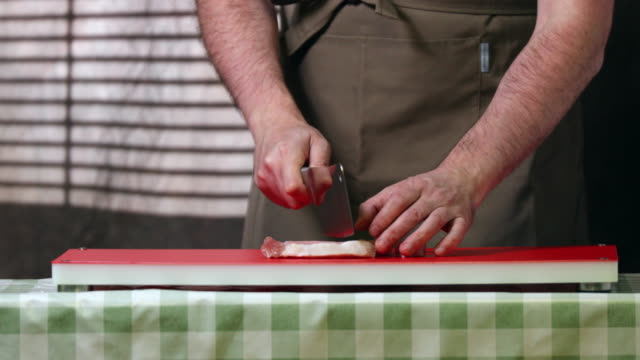 cook chopping pork meat. - vorderansicht stock-videos und b-roll-filmmaterial