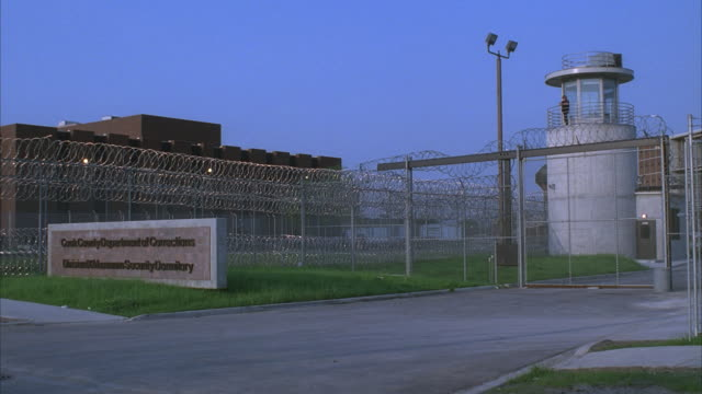 MS, Cook County Jail, watch tower and building behind barbed wire, Cook County, Illinois, USA