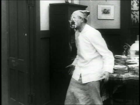 b/w 1916 cook getting pie thrown in face / short - 1916 stock videos & royalty-free footage