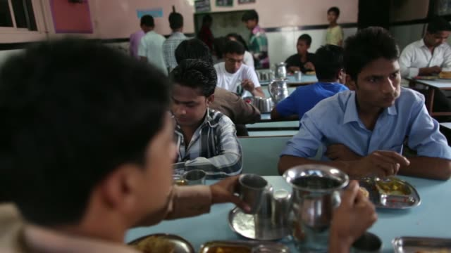 a cook makes bread at a restaurant in the dharavi slum area of mumbai india on tuesday aug 12 customers eat at a restaurant in the dharavi slum area... - sugar cane stock videos & royalty-free footage