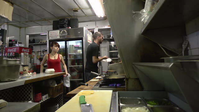 ms zi cook making to go order of chili cheese fries at classic american diner / ann arbor, michigan, united states - waitress stock videos & royalty-free footage