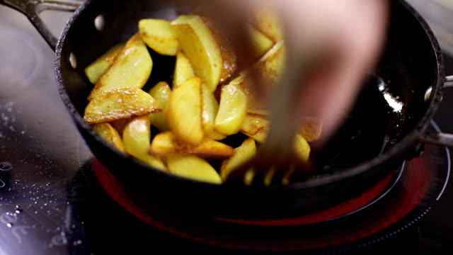 Cook potatoes in a frying pan