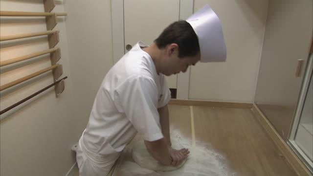 ms cook preparing dough for soba noodles, tokyo, japan - soba stock videos & royalty-free footage
