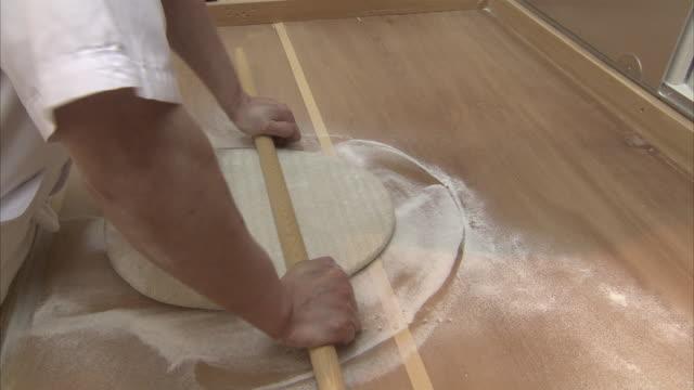 cu cook preparing soba dough, tokyo, japan - noodles stock videos & royalty-free footage