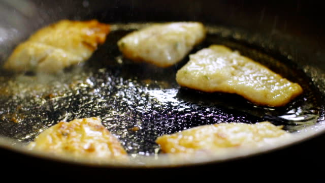 cook puts the fillet of fish on the frying pan - branch plant part stock videos & royalty-free footage