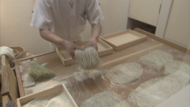 ms cook putting soba noodles to boxes, tokyo, japan - soba stock videos & royalty-free footage