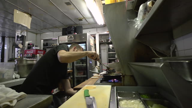 ms cook scrambling eggs on stove and prepares burger at classic american diner / ann arbor, michigan, united states - fast food stock videos & royalty-free footage