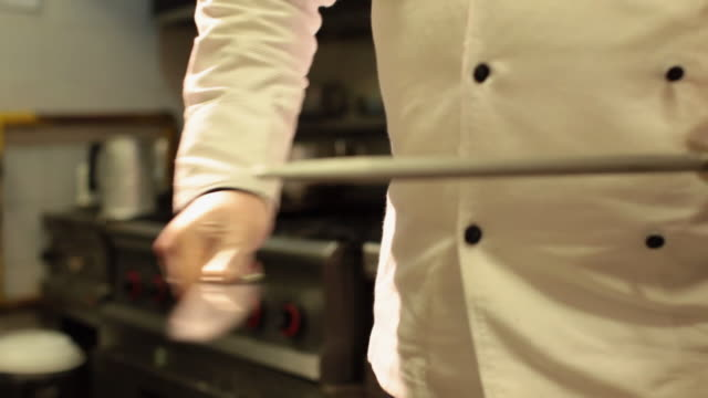 ms cook sharpening knife at a restaurants kitchen / sao paulo, brazil - knife weapon stock videos & royalty-free footage