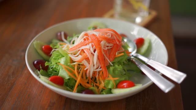 cook vegetable salad with cream. - dining stock videos and b-roll footage