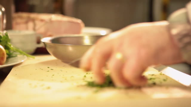 ms r/f cook/chef preparing a lobsters dish typical brazilian food chopping parsley / sao paulo, brazil - parsley stock videos and b-roll footage