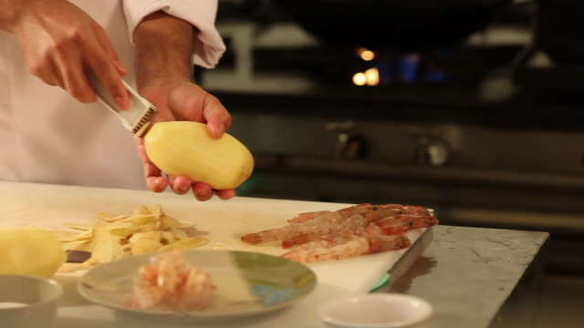 ms r/f cook/chef preparing a prawn tempura dish, typical japanese food peeling a potato / sao paulo, brazil - peeling food stock videos & royalty-free footage