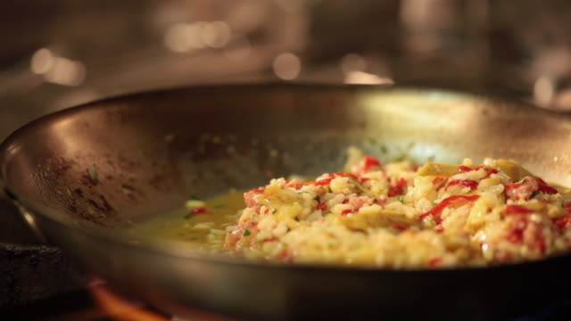 ms cook/chef preparing a risotto artichoke and meat risotto cooking the ingredients / sao paulo, brazil - risotto stock videos & royalty-free footage