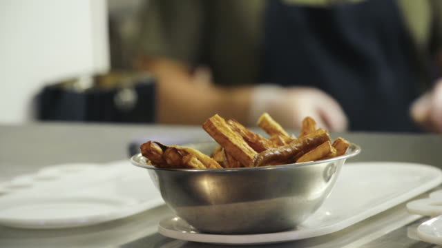cooked french fries in a bowl - bowl stock videos and b-roll footage