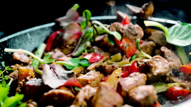 Cooked meat meal with vegetables