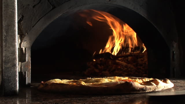 hd: cooked pizza - pizza oven stock videos and b-roll footage