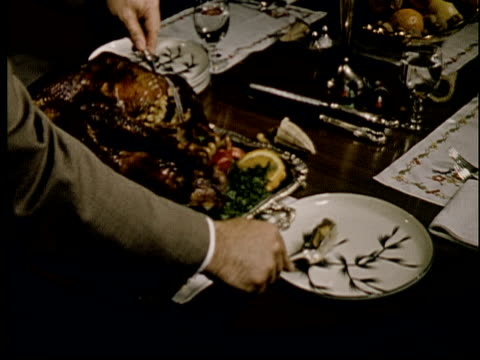 1955 cu cooked thanksgiving turkey on dinner table/ cu man removing stuffing from turkey/ ecu stuffing on plate  - thanksgiving plate stock videos & royalty-free footage