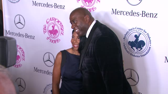 cookie johnson and earvin 'magic' johnson at the 2014 carousel of hope ball at the beverly hilton hotel on october 11, 2014 in beverly hills,... - the beverly hilton hotel点の映像素材/bロール