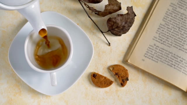 cookies and cup of tea on wooden background, slow motion. - detox stock videos & royalty-free footage