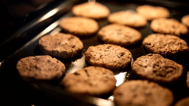 cookies in the oven time lapse - chocolate chip stock videos & royalty-free footage
