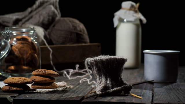 cookies, milk and knitting - ball of wool stock videos & royalty-free footage