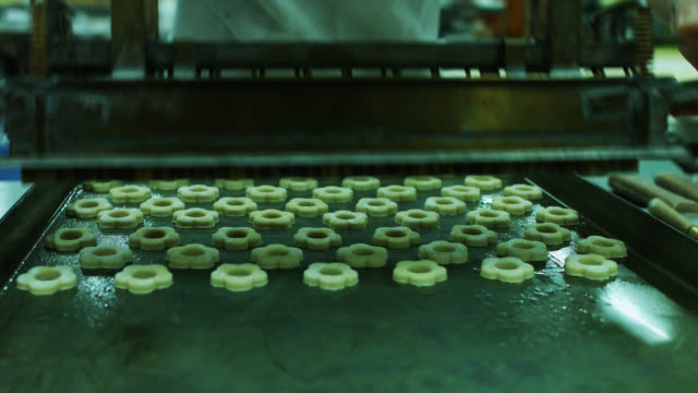 cookies pressed from mould onto baking tray - baking tray stock videos & royalty-free footage