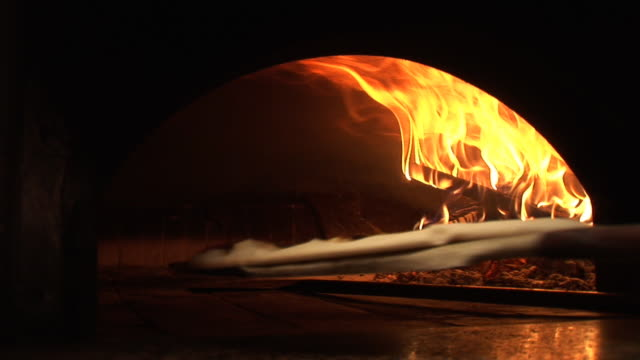 hd: cooking a pizza - pizza oven stock videos and b-roll footage