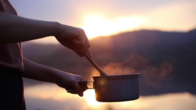 cooking and camping at sunset on holiday - heat stock videos & royalty-free footage