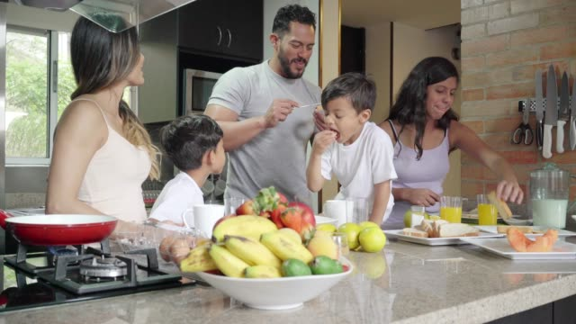 cooking breakfast with the family - healthy eating stock videos & royalty-free footage