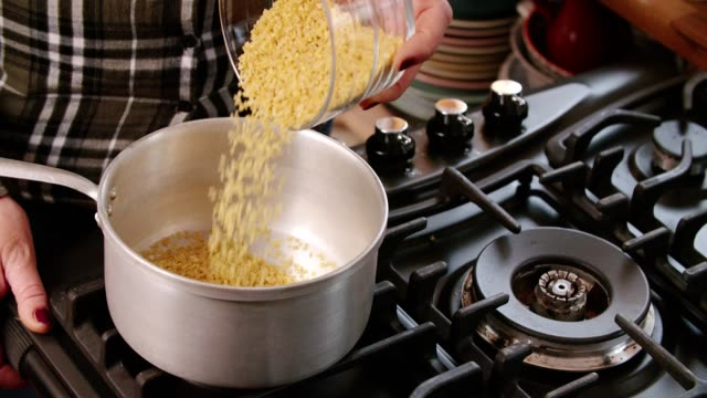cooking bulgur in a cooking pot - quinoa salad stock videos & royalty-free footage