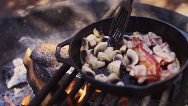 cooking camp breakfast - cast iron stock videos & royalty-free footage