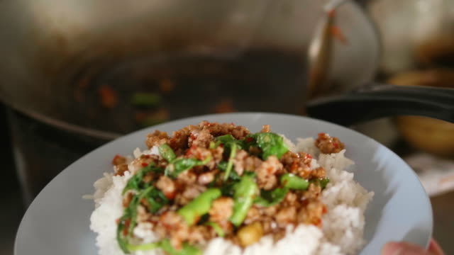 Cooking Chicken fried rice with basil , Thai food