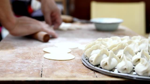cooking chinese dumpling(jiaozi) - chinese language stock videos & royalty-free footage