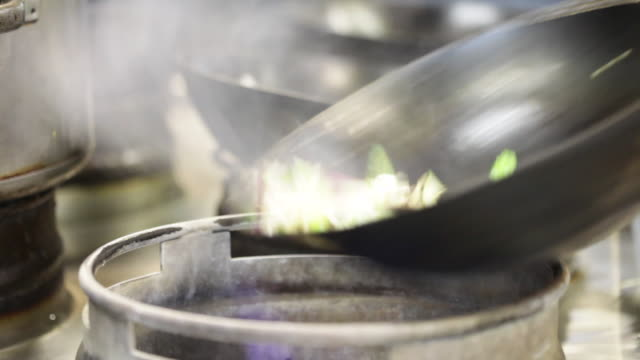 Cooking Chinese food in a wok, UK
