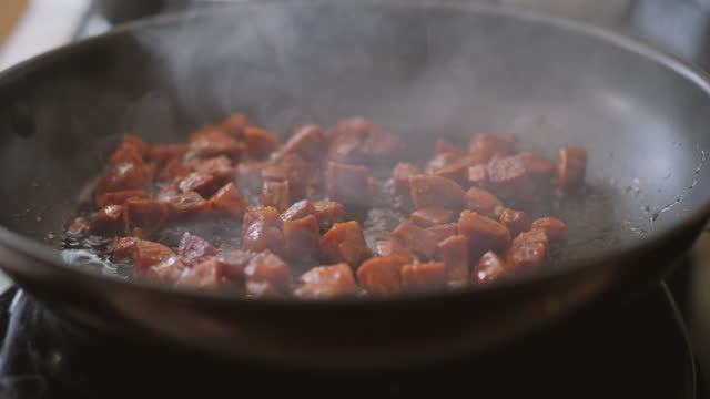 cooking chopped chorizo sauce using frying pan - chorizo stock videos & royalty-free footage