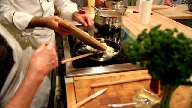 cooking class - sauteing onions - showing stock videos and b-roll footage