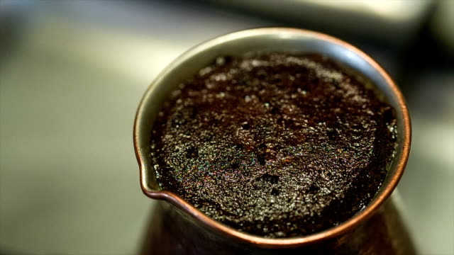 cooking coffee in the morning. closeup. - coffee drink stock videos & royalty-free footage