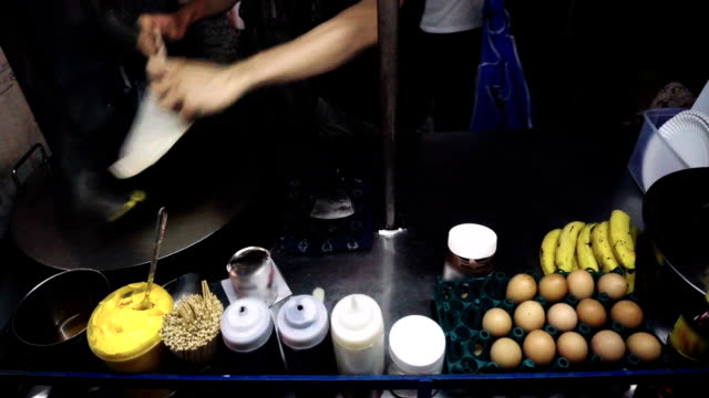 Cooking crepes on the night market in Thailand